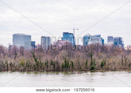 Washington Dc, Usa - March 20, 2017: People Rowing On Potomac River On Boat With Skyline Of Arlingto