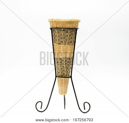 Vases are made of wicker placed on a wrought iron base hand made cone shaped isolated on white background