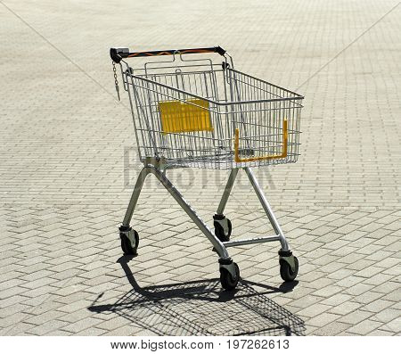 An Emrty Shopping Trolley On Road 02
