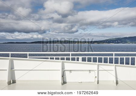 Norwegian cruise handrail detail. Fjord landscape. Summer holiday outdoor. Norway.