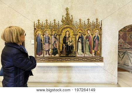 VERONA ITALY - MAY 1 2016: Madonna and Child with Saints known as The Aquila Polyptych in Castelvecchio Museum. Verona Italy