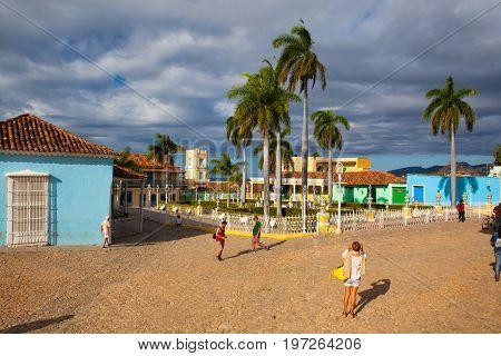 Trinidad Cuba - January 30 2017: Plaza Mayor -Principal square of Trinidad. Typical colonial building with window wooden grate in Trinidad Cuba. One of UNESCOs World Heritage sites since 1988. Sancti Spiritus Province Cuba.