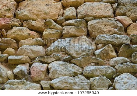 Ancient stone wall with rough irregular stones