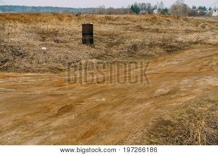 Rusty Barrel On Field