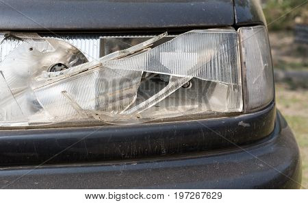 damaged car headlamp after collision on road