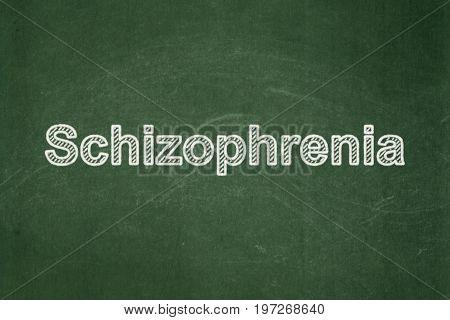 Medicine concept: text Schizophrenia on Green chalkboard background