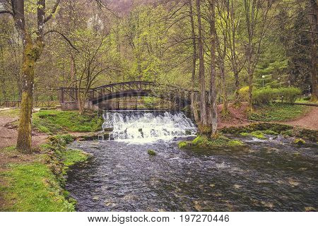 Wooden Bridge With Waterfall In Nature Park Vrelo Bosne 2