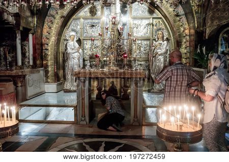 Jerusalem Israel July 14 2017 : Fragment of the interior of the Church of the Holy Sepulchre in Jerusalem Israel. The Believer touches Golgotha.