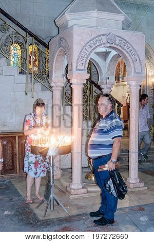 Jerusalem Israel July 14 2017 : Fragment of the interior of the Church of the Holy Sepulchre in Jerusalem Israel. Believers light candles.