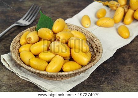 Raw yellow date palm or Dates, healthy fruit