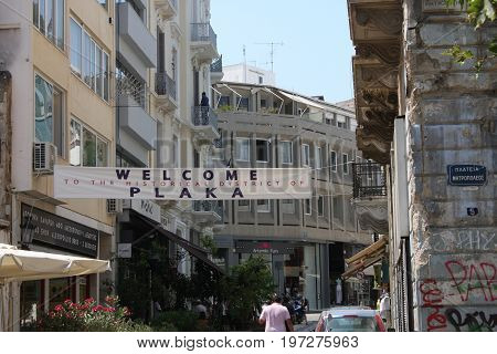 Athens, Greece: July 14, 2017 - The Plaka is the oldest section of Athens. Area of restaurants, Jewelry stores tourist shops, and cafes.