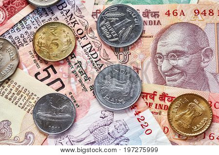 Close up picture of Indian rupee coins and banknotes.