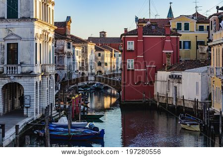 The old town and the canals at dusk in Chioggia Italy