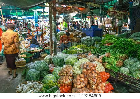 Lampang. Thailand - July 04 2016: People sale raw food product from around the country in every morning at the market in rurul countryside in Asia Thailand.