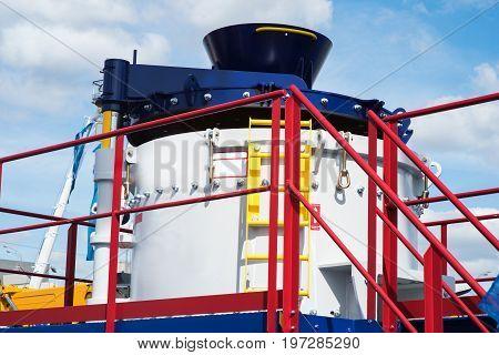 Heavy mining dump truck unloading ore into hopper crusher