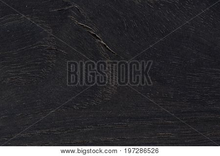 Black natural wood texture. High resolution photo