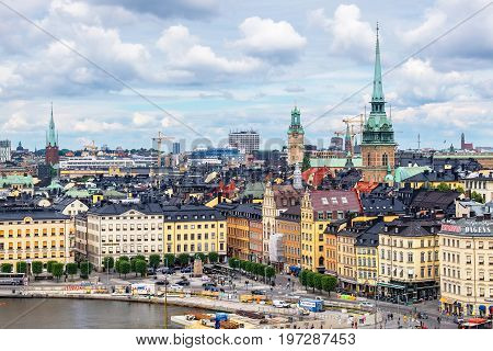 STOCKHOLM SWEDEN - JULY 08 2017: Spires of German Church and Stockholm Cathedral rises above the rooftops of the Gamla Stan