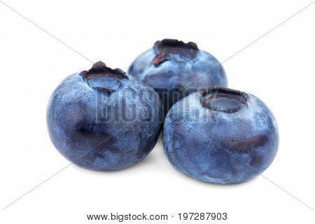 A close-up of a group of three blueberries, isolated on a white background. Organic and healthy berry vitamins. A composition of the three blueberries full of vitamins. Ripe and rustic ingredients.