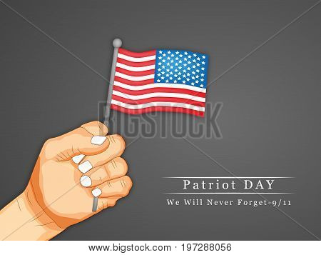illustration of hand holding USA flag with Patriot Day We will never Forget text on the occasion of Patriot Day
