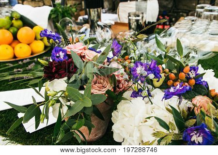 Elegant Table Arrangement And Catering At Wedding Reception, Stylish Bouquet Centerpiece