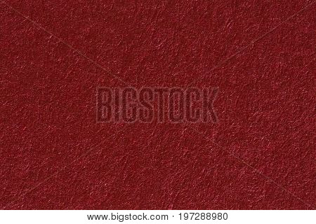 A vintage red background with a crisscross mesh pattern and grunge stains. High resolution paper.