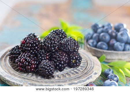 Fresh Summer Wild Blueberries And Brambleberry, Blackberry In Stone Bowls