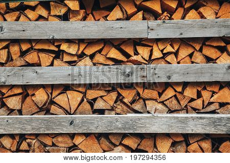 Abstract photo of a pile of natural wooden logs background, top view
