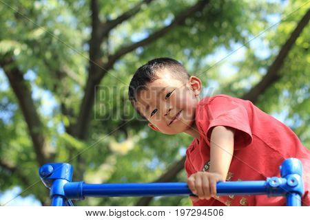 Japanese Boy On The Jungle Gym (3 Years Old)