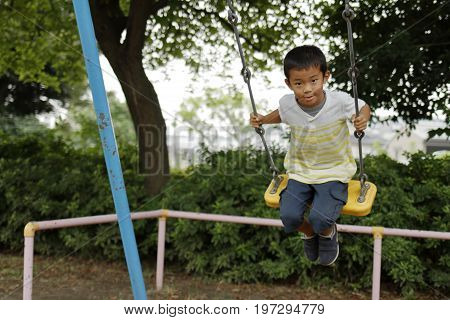 Japanese Boy On The Swing (second Grade At Elementary School)