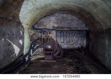 Abandoned unfinished soviet bunker with remnant of  ventilation equipment in Sevastopol