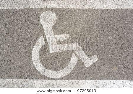 Close up disabled parking sign on asphalt