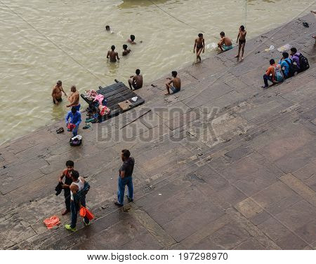 People On Ganges Riverbank In Varanasi, India