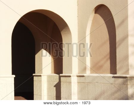 arched passage way in a church building poster