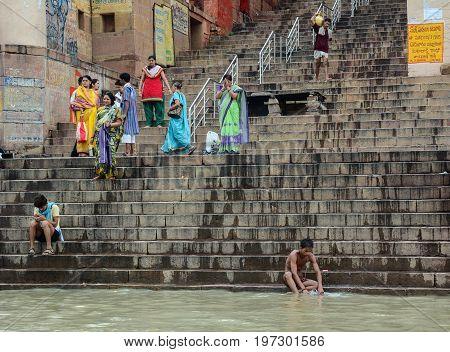 People On Ganges Riverbank In Varanasi, India