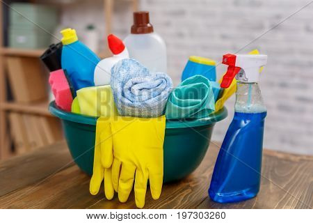 Studio shot of housekeeper's objects. There is bowl full of bottles with disinfectant