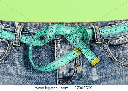 Blue Jeans With Blue Measure Tape Belt