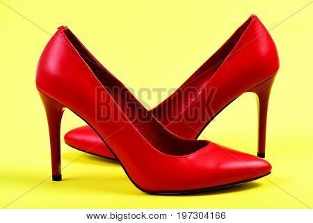 Fancy Female Shoes In Red Color On Yellow Background