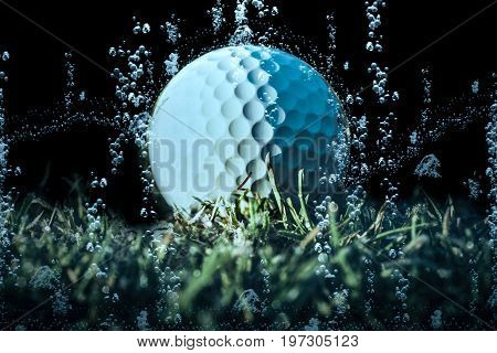 Closeup of a white golf ball lying on the bottom of a pond
