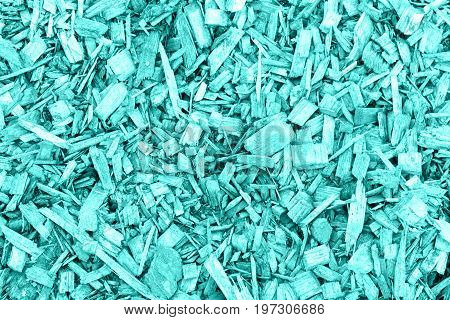 Closeup shot of green and blue mulch used for garden decorating