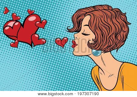 Woman making a kiss heart. Pop art retro vector illustration