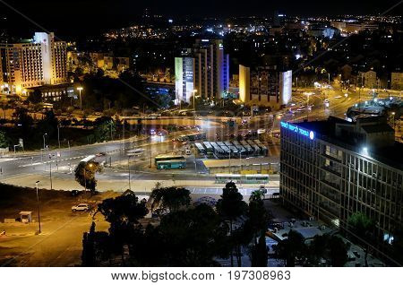 JERUSALEM ISRAEL - JUNE 26 2017: View of the Givat Yam district in Jerusalem at night. Inscriptions: announcements about events names of institutions