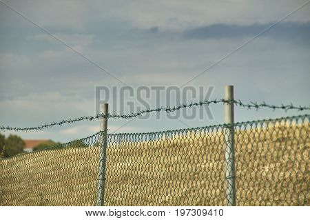 The Net And The Barbed Wire