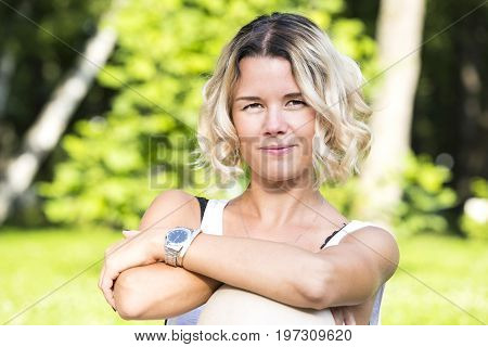 Portrait of a girl in a summer park outdoors