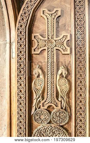 Carved cross on the front wooden door in the Church of the Martyr Gayane in Echmiadzin