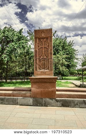 Stone carved cross on the territory of the Church of Martyr Gayane in Etchmiadzin