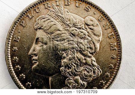 Macro shot of Morgan Dollar coin toned image.