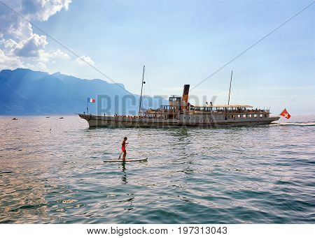 Woman Standup Paddle Board And Excursion Ship Vevey Swiss Riviera