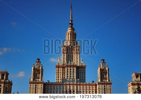 MOSCOW RUSSIA - OCTOBER 13 2015: Main building of Lomonosov Moscow State University or MSU at sunset against bright blue sky. Education in Moscow Russia