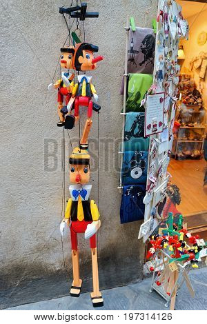 Street Souvenir Shop With Wooden Pinocchio Puppets In Siena