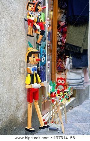 Street Souvenir Shop With Wooden Pinocchio Puppets Siena